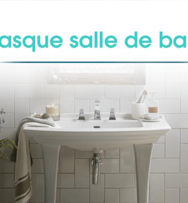 lavabo sur colonn dans une salle de bain aux murs carrelés avec des produits et accessoires d'hygiène tout autour