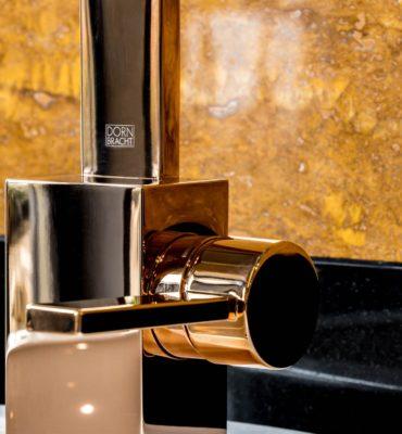 Poignée robinet Dornbracht dorée